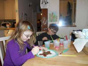 Painting Icing on Gingerbread People.